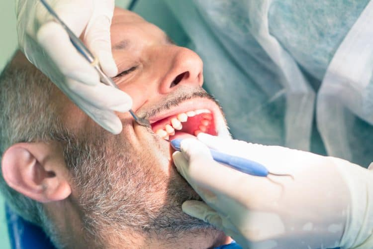 Patient undergoing dental filling for cavity