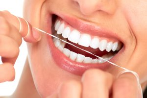 flossing as part of a strong oral routine