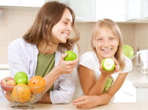 an image of two people eating snacks